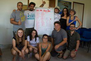 Alcuni dei volontari di Ali sul Lago con la lista delle specie 2013